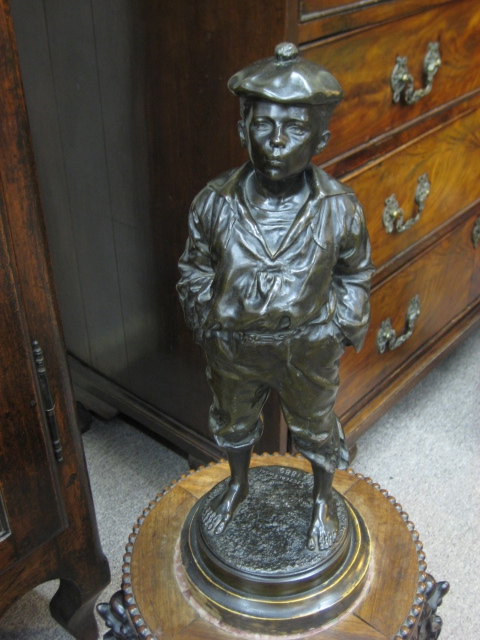 A Polish Bronze Figure Of A Boy