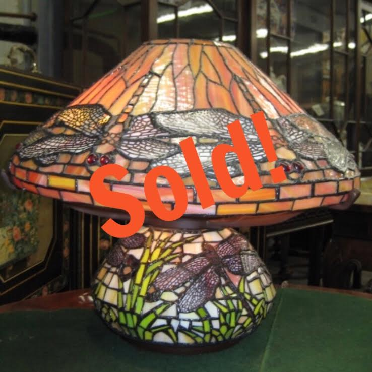 A Multicolored Lamp In A Dragon Fly Motif