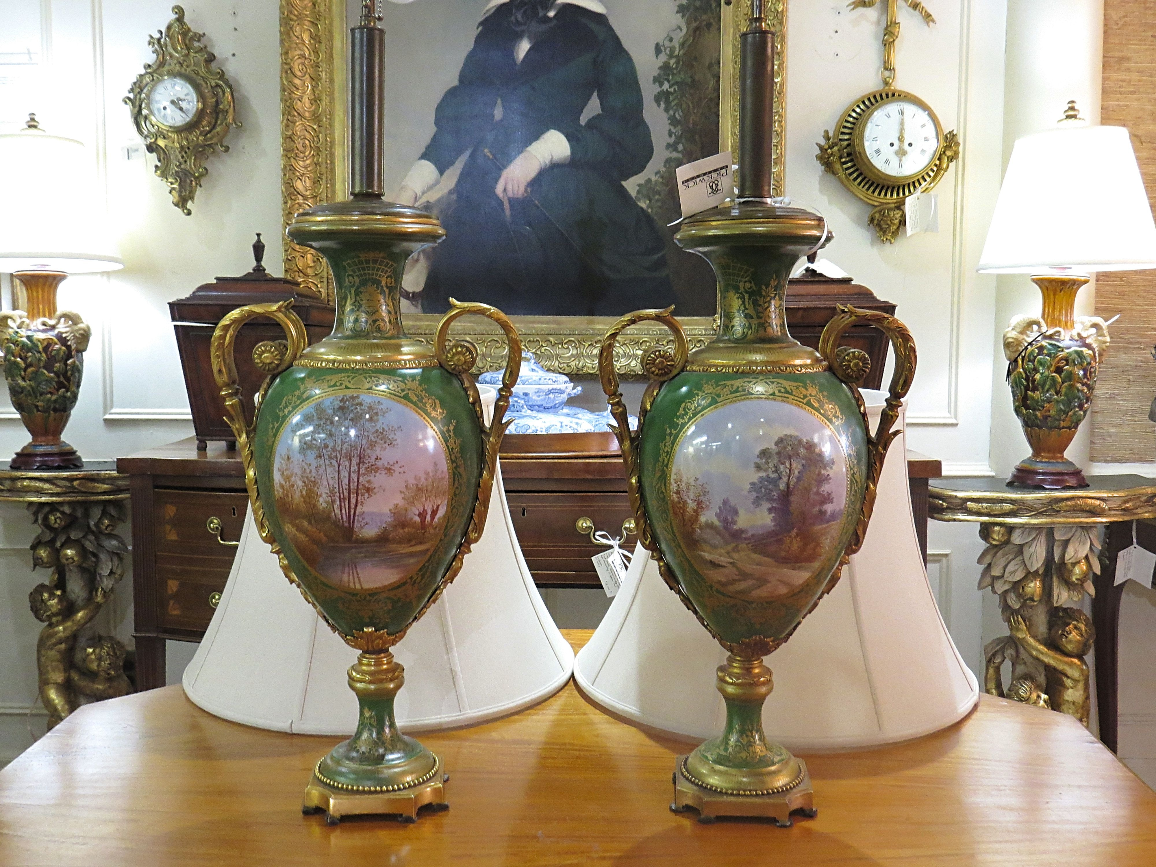 Pair Of Bronze Mounted Sevres Porcelain Urns Adapted As Lamps.