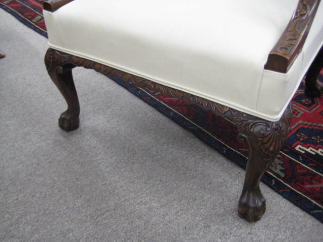 An Irish Chippendale Style Mahogany Gainsborough Armchair.