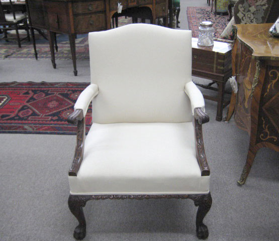 An Irish Chippendale Style Mahogany Gainsborough Armchair.