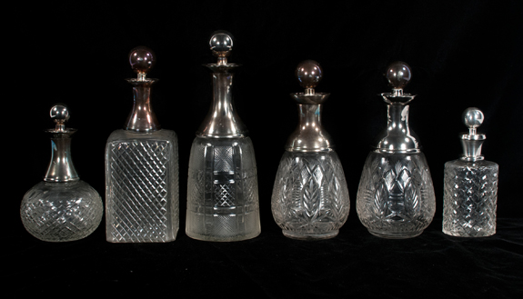 Collection of Six Cut Crystal Decanters with Silver Plated Mounts