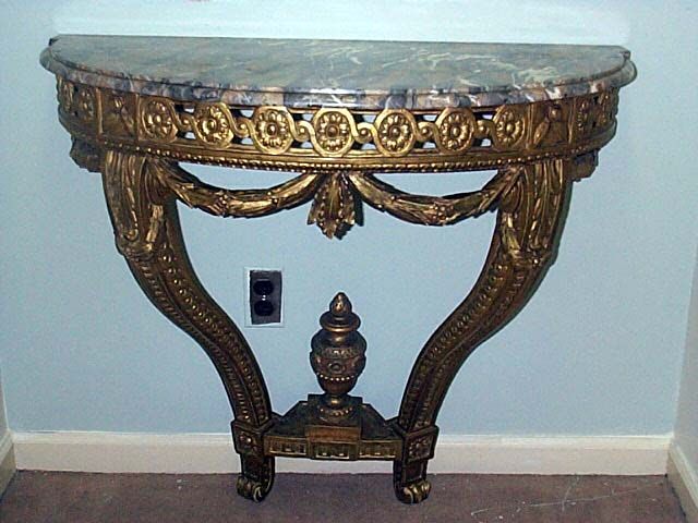 A Napoleon III Carved Giltwood Console Table.