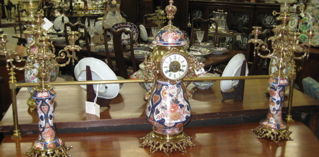 French Bronze And Bronze Mounted Mantle Clock And Candelabras