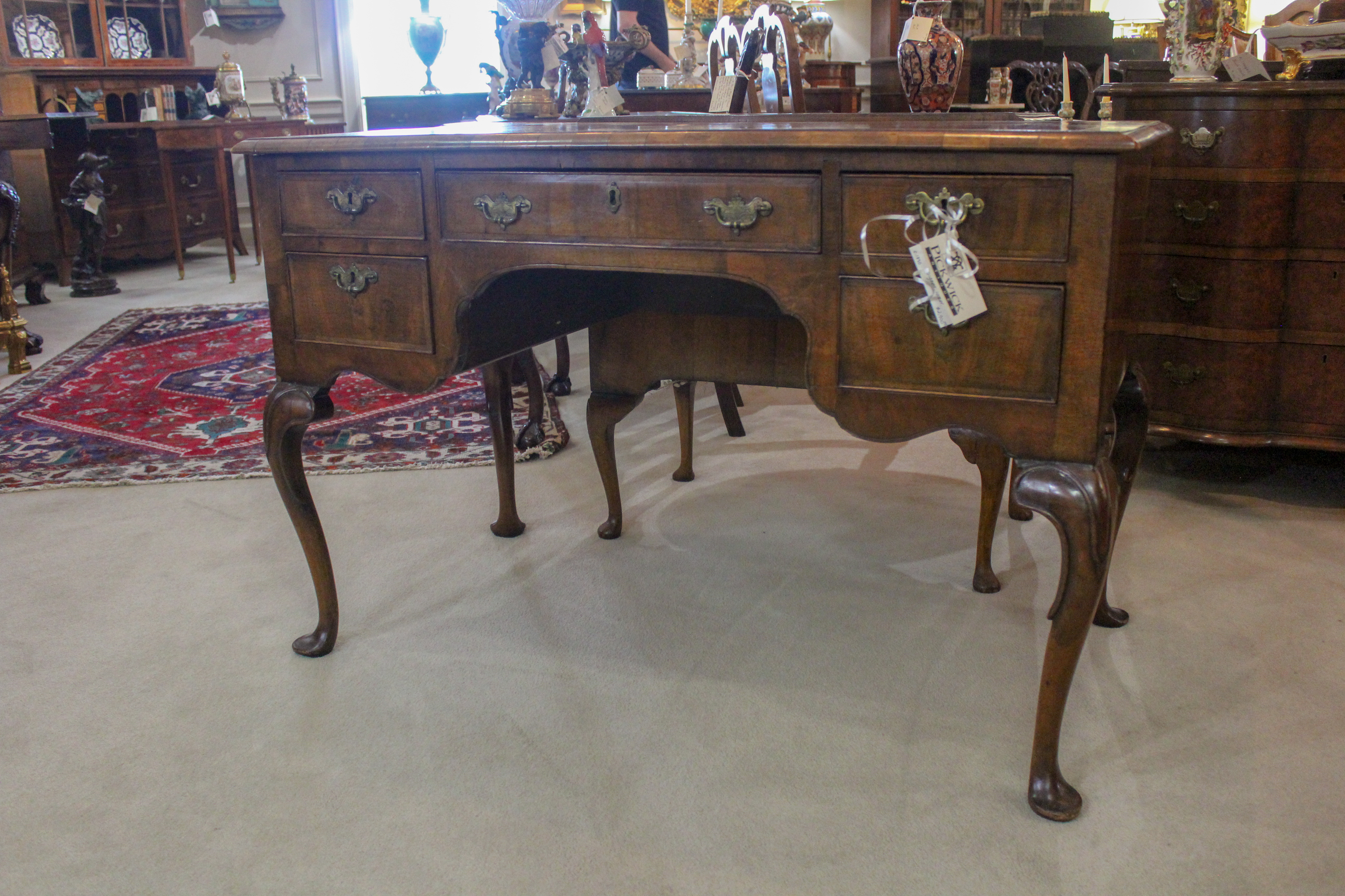 An English Queen Anne Style Walnut Writing Table