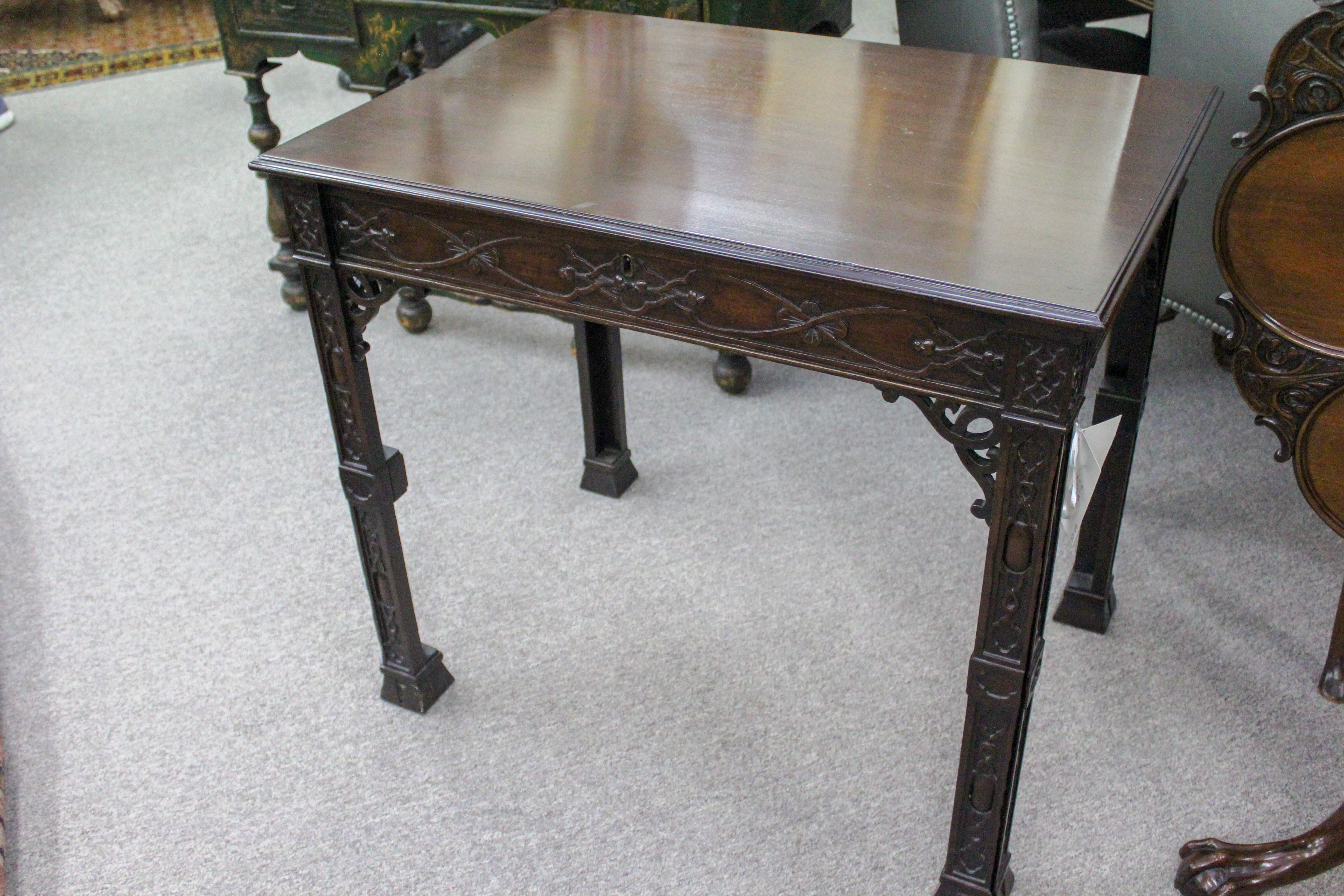 An English Chippendale Mahogany Writing Table with Blind Fret