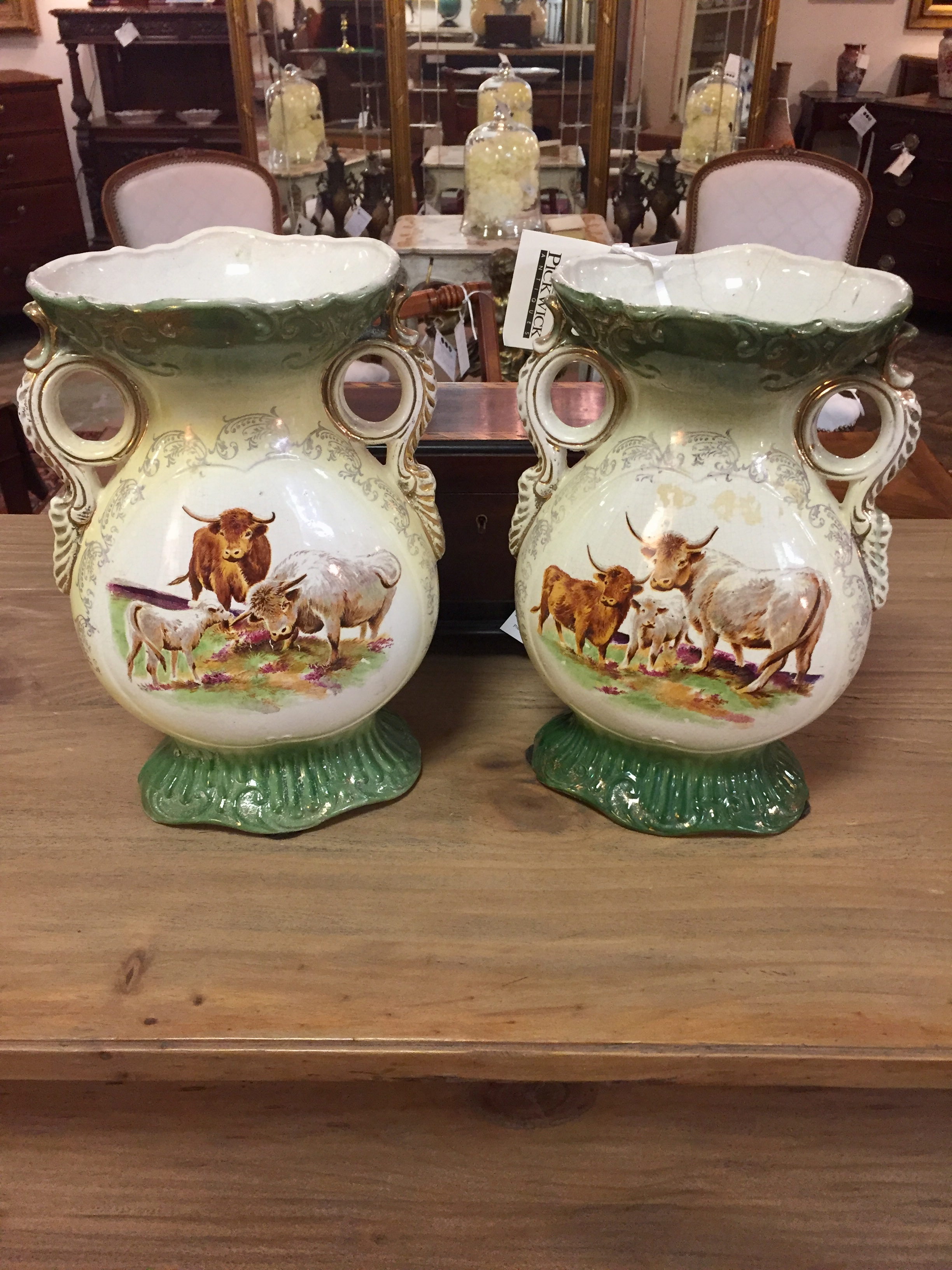 A Pair of Double Handled Porcelain Vases with Cow Decorations
