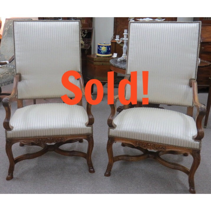 A Pair of French Open Arm Chairs